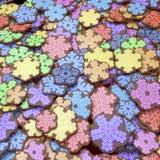 Cookies coloridas do xmas no projeto do floco de neve Fotografia de Stock Royalty Free