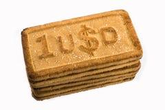 Cookies com os símbolos de moeda Fotografia de Stock