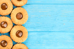Cookies with condensed milk. On a blank wooden background, top view royalty free stock photo