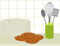 Cookies on counter. Plate of chocolate chip cookies on a counter with a plate stack and a container of cooking utensils royalty free illustration