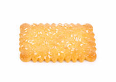 Cookies cracker biscuits sprinkled with sesame on a white backgr Royalty Free Stock Photography