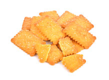 Cookies crackers biscuits sprinkled with sesame on a white backg Royalty Free Stock Images