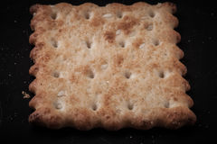 Cookies crackers and crumbs on a dark background Royalty Free Stock Image