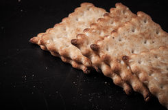 Cookies crackers and crumbs on a dark background Royalty Free Stock Images