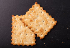 Cookies crackers and crumbs on a dark background Royalty Free Stock Photos