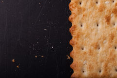 Cookies and crackers crumbs on a dark background with place for Royalty Free Stock Photography