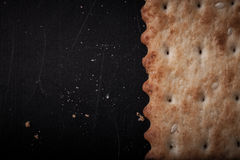 Cookies and crackers crumbs on a dark background with place for Royalty Free Stock Image