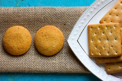 Cookies crackers in a white saucer and matting Royalty Free Stock Photo