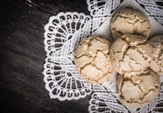 Cookies with cracks on a white lacy napkin Stock Photo