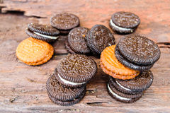 Cookies cream back and brown. On woodden table Stock Photos