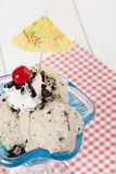 Cookies and cream ice cream with cherry. And umbrella Stock Photography