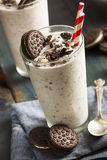 Cookies and Cream Milkshake. Homemade Cookies and Cream Milkshake in a Tall Glass stock photos
