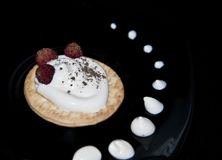 Cookies with cream and strawberries on a plate stock images