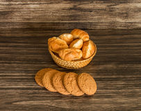 Cookies and croissants. On a wooden background Stock Photos