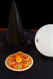 Cookies and Crystal Ball. Plate of cookies with witch hat and crystal ball Stock Photo