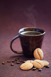 Cookies and cup coffee. Coffee bean cookies and cup of hot coffee, selective focus Royalty Free Stock Photos