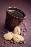 Cookies and cup coffee. Coffee bean cookies and cup of coffee, selective focus Stock Photography