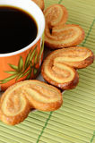 Cookies and a cup of coffee. Heart shaped cookies around a cup of coffee Stock Image