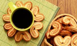 Cookies and a cup of coffee. Cookies around a cup of coffee and in a basket Royalty Free Stock Images