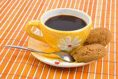 Cookies and cup with coffee. Close-up cookies and cup with coffee on bamboo table-cloth Royalty Free Stock Photography