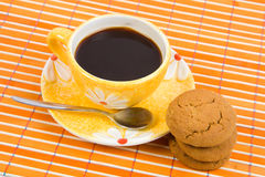 Cookies and cup with coffee. Close-up cookies and cup with coffee on bamboo table-cloth Stock Photography