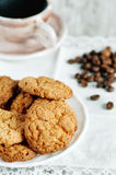 Cookies, cup of coffee and coffee beans Stock Photos