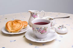 Cookies and a cup of tea. With milk and sugar Stock Photo