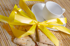 Cookies and cup of tea on bamboo mat, background Royalty Free Stock Images