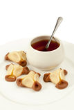 Cookies and cup of tea on plate Royalty Free Stock Photography