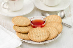 Cookies with cups of tea Royalty Free Stock Photography