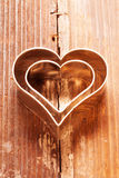 Cookies cutter heart on wood Stock Photo