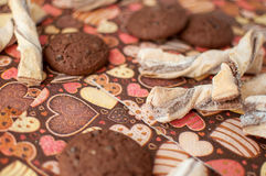 Cookies on dark napkin with image of hearts Stock Photos
