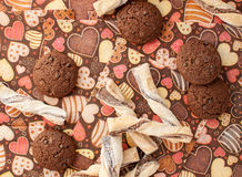 Cookies on dark napkin with image of hearts Royalty Free Stock Images