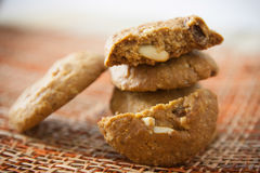 Cookies. On dark napkin on wooden table with copyspace. Closeup of a group of assorted Royalty Free Stock Photo