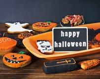 Cookies de Dia das Bruxas e cumprimentos do feriado Fotografia de Stock Royalty Free