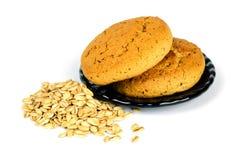Cookies de farinha de aveia e flocos da aveia fotografia de stock