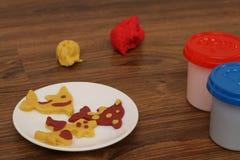 Cookies de Playdough em uma placa Fotos de Stock