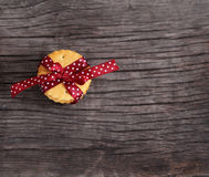 Cookies decorated with dark red polka dots ribbon Royalty Free Stock Photos