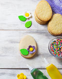 Cookies with decorations tools – icing, marzipan flower, nonpa Stock Photography