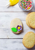 Cookies with decorations tools – icing, marzipan flower, nonpa Stock Photos