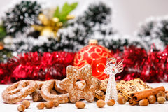 Cookies and decorative glass angel. On de-focused christmas theme background stock photos