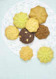 The cookies. The different variaty of cookies on the white cake sheet and pale blue background Stock Image