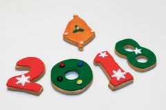 Cookies 2018 do ano novo do Natal no fundo branco Imagem de Stock Royalty Free