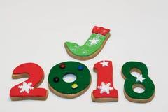 Cookies 2018 do ano novo do Natal no fundo branco isolado Foto de Stock