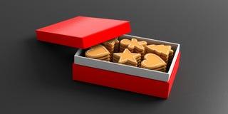Cookies do pão-de-espécie do Natal, caixa de presente vermelha, fundo preto fotos de stock
