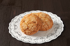 Cookies on a doily Stock Images