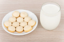 Cookies with egg glaze in saucer and glass milk Royalty Free Stock Photos