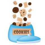 Cookies falling in the jar. Cookies falling in the blue jar Stock Image
