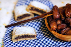 Cookies filled with dry dates dusted with sugar, dessert Royalty Free Stock Image