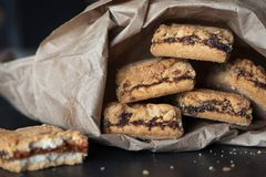 Cookies filled with jam in a paper package stock photography